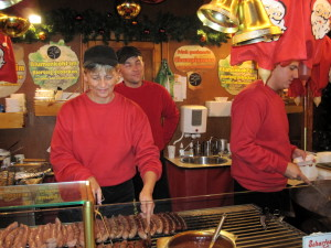 """DEU BSer Weihnachtsmarkt Bratwurststand Schlemmerking EV MSZ091126"" by Monstourz - Own work. Licensed under CC BY-SA 3.0 via Wikimedia Commons - https://commons.wikimedia.org/wiki/File:DEU_BSer_Weihnachtsmarkt_Bratwurststand_Schlemmerking_EV_MSZ091126.jpg#/media/File:DEU_BSer_Weihnachtsmarkt_Bratwurststand_Schlemmerking_EV_MSZ091126.jpg"